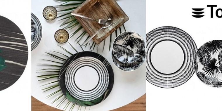 Porcelán tányérok és alátétek az ízléses terítékhez